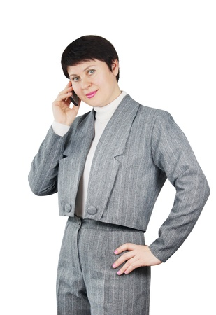 Woman Dressed In Gray Suit Talks By Phone photo