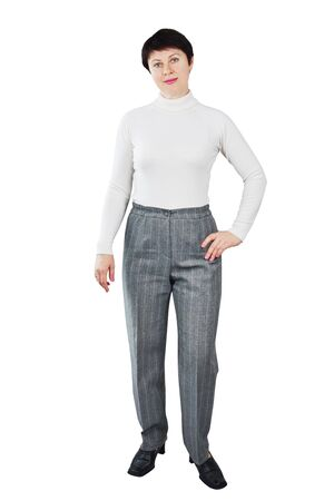 Woman Dressed In White Turtleneck And Grey Trousers photo