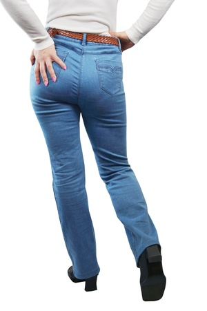 Female Legs Dressed In Blue Jeans. View From The Back photo