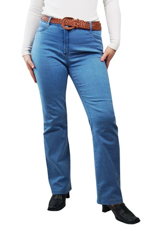 Female Legs Dressed In Blue Jeans Stock Photo