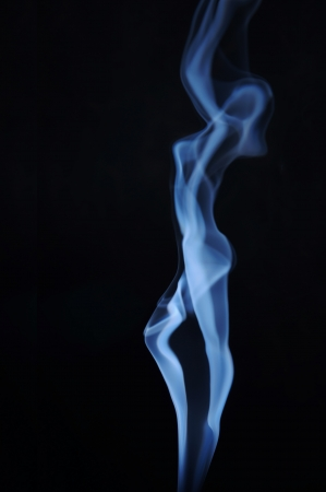 female form: Fuming image of beautiful lady made of smoke Stock Photo