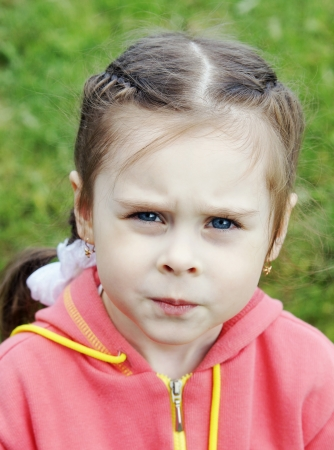 Close-up portrait of serious little girl photo