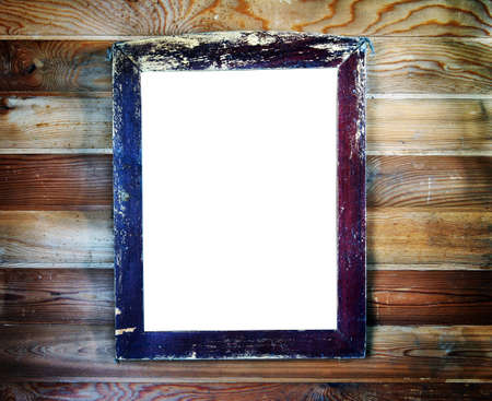 Old vintage wooden frame with empty space for text hanging on the wall Stock Photo - 22499494