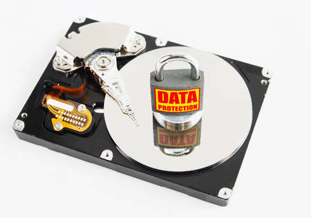 Locked padlock over hard disk drive photo