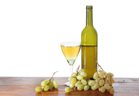 Bottle of wine and grape bunches isolated over white                                photo