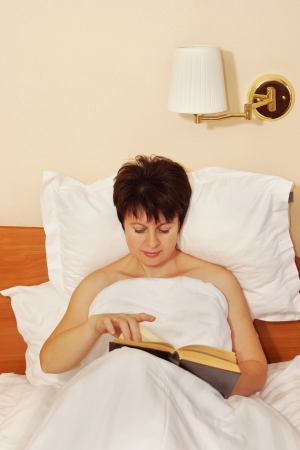 Woman reading a book before sleeping Stock Photo - 23453956
