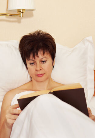 Woman reads a book before sleeping Stock Photo - 23453958