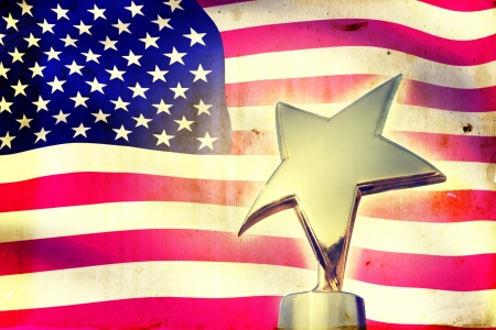 Gold star award against vintage USA flag photo
