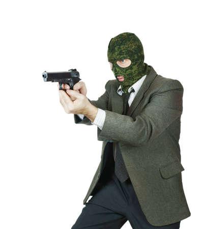 culprit: Gangster shooting with a handgun Stock Photo
