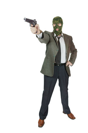 perpetrator: Gangster shooting with a pistol Stock Photo