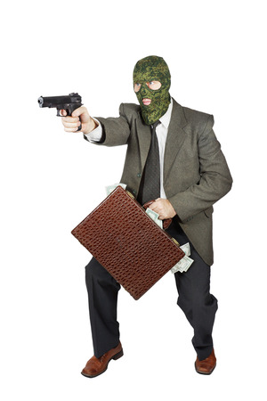perpetrator: Burglar with the gun and a suitcase full of money Stock Photo