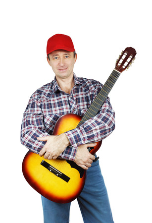 Adult man holding a guitar Stock Photo - 24466728