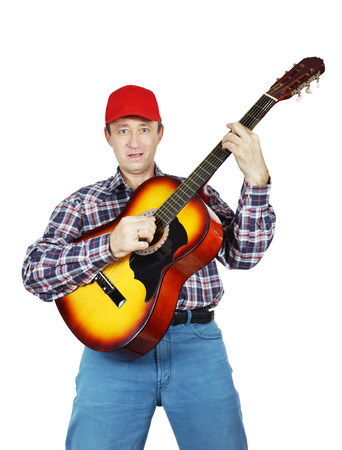 Adult man playing a guitar Stock Photo - 24466816