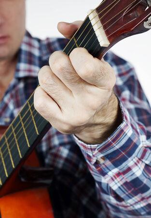 chord: Man plays a chord on guitar Stock Photo