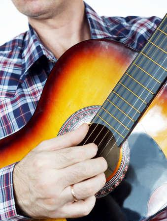 Musician plays guitar Stock Photo - 24459212