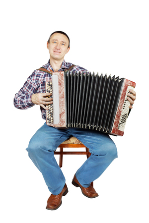 Man with harmonica sits on a chair photo