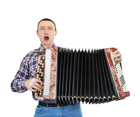 Singing man with harmonica photo