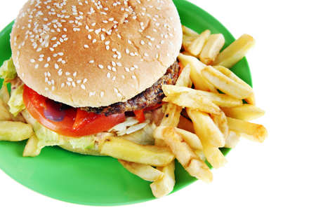 Hamburger with French fries in the plate photo
