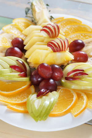 assort: Diverse assorted fruits in a large dish