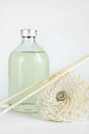Sandalwood oil in a glass bottle and sticks for spa procedures Stock Photo
