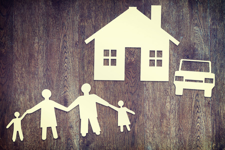 happy family concept: Happy family  Paper scraps on wooden surface
