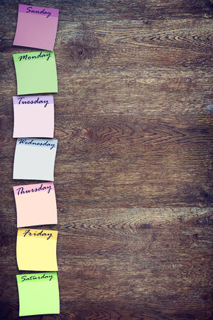 weekly: Weekly planning board with multicolored stickers Stock Photo