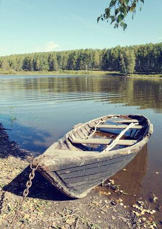olden: Old wooden boat on the lake