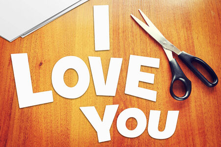 love confession: Text I Love You. Scraps of paper Stock Photo