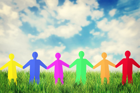 Concept of unity and friendship. Many multicolored paper people characters stand outdoor together photo