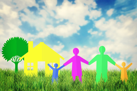 Concept of happy family near their  home outdoors against blue sky photo