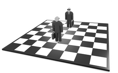 Two businessmen stand on the chessboard before each other photo