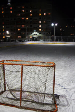 Empty hockey gate at an ice rink in the evening 免版税图像