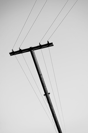 rickety: Old rickety wooden electric pole with wires Stock Photo