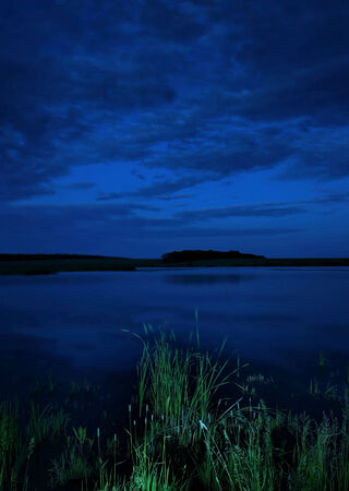 tonight: Landscape at the lake in the summer night Stock Photo