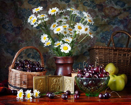 Still life with bouquet of camomile and cherries