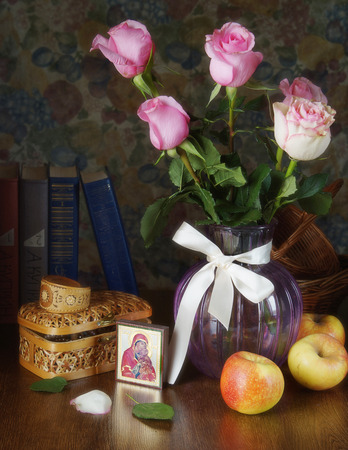 mother mary: Still life with roses in a vase and an icon of Mother Mary