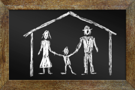 Concept of happy family. Drawing with chalk on the blackboard photo
