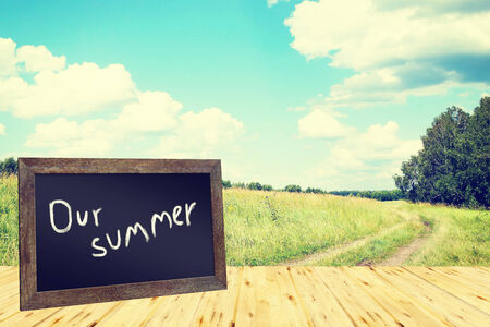 recollections: Summer concept with blackboard and sunny landscape Stock Photo