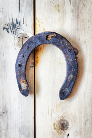 pitting: Old rusty horseshoe hanging on a nail. Easy HDR effect