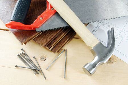 hobnail: Carpenter working tools on the wooden workbench Stock Photo