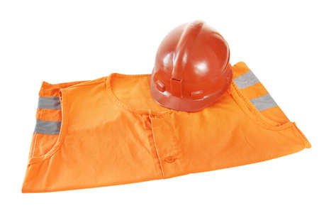 Working bright orange vest and a helmet isolated over white background photo