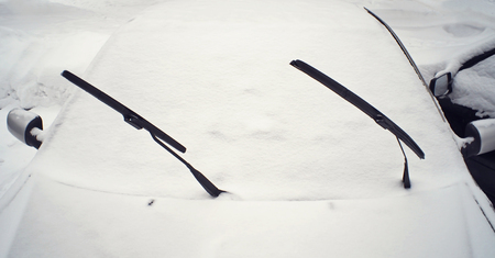 inclement: Car covered with fresh snow Stock Photo