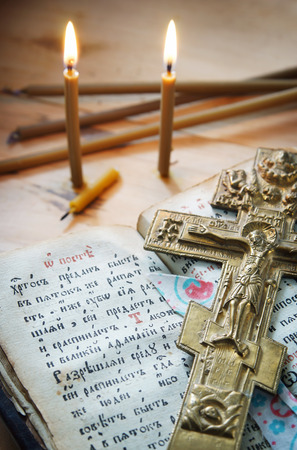 godly: Christian still life with old metal cross and ancient book
