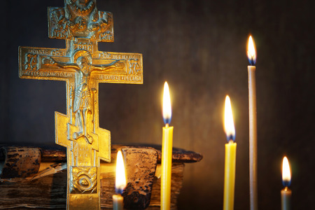 godly: Orthodox Christian still life with ancient metal crucifixion and burning candles
