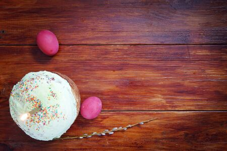 easter candle is burning: Composition about Orthodox Christian Easter with red eggs and a cake Stock Photo