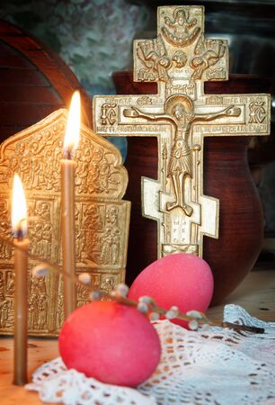 godly: Orthodox Christian Easter still life with red eggs and metal ancient cross
