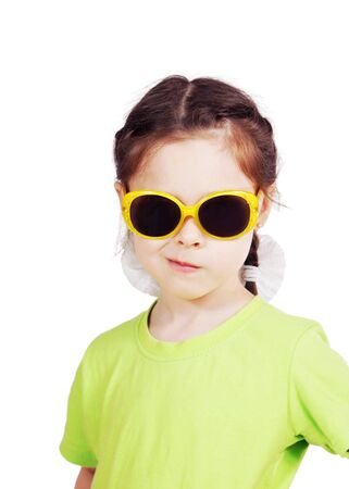 smirking: Smirking cute little girl with sunglasses Stock Photo
