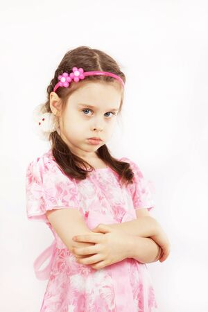 resent: Little pretty girl wearing beautiful pink dress is angry
