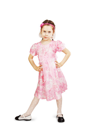 unruly: Little pretty naughty girl wearing beautiful pink dress over white background Stock Photo