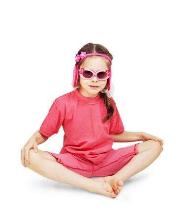 Little cute girl wearing pink clothes sitting over white background photo